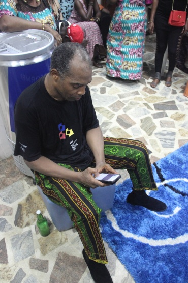 Femi Kuti on the Phone with Son, Made.