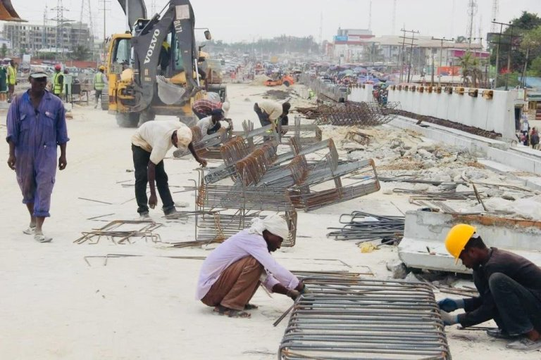 Workers on Ajah Bridge